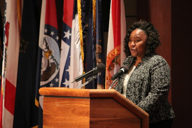 Service to others defines Nichole Massey's leadership message during her presentation at the Dec. 11 graduation ceremony for 53 students who participated in the Leader Investment for Tomorrow program at Redstone Arsenal, Ala. Massey, who works for the Aviation and Missile Command's G-3/5, graduated from the UpLIFT class.