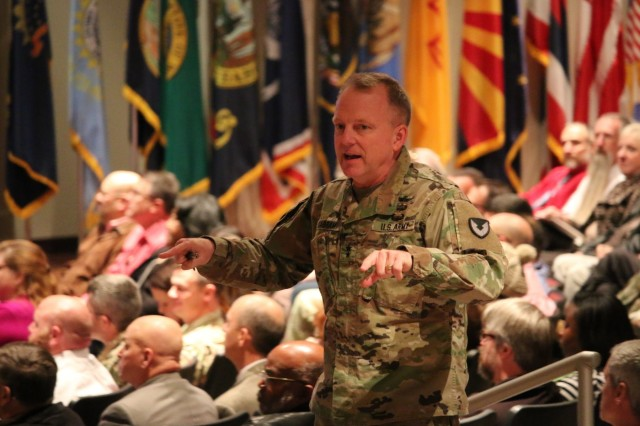 Employees from across the Aviation and Missile Command attend the Dec. 11 town hall, during which AMCOM commander Maj. Gen. Doug Gabram provided an insight into senior leader priorities, the AMCOM Campaign Plan and the importance of trust throughout the AMCOM organization.