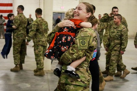 A Soldier with the 82nd Combat Aviation Brigade, 82nd Airborne Division, embraces her daughter during a home coming ceremony on Pope Army Airfield Green Ramp, Feb. 11, 2017. The Soldiers are home after they successfully provided CH-47 Chinook and per...