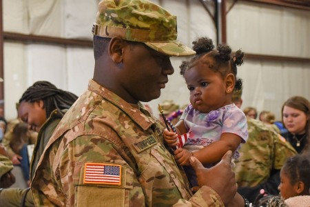 Soldiers with the South Carolina Army National Guard, bid farwell by family and friends during a deployment ceremony held at Eagle Aviation in Columbia S.C., Feb. 26, 2017.