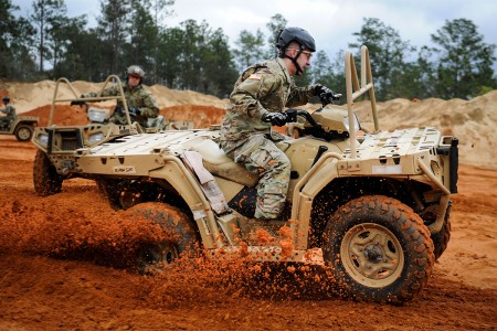 A Soldier with 10th Special Forces Group, executes a sharp turn in an all-terrain vehicle at Buck Pond in Navarre, Fla., March 14, 2017. An instructor with the 1st Special Operations Support Squadron Operational Support Joint Office trained Soldiers on riding techniques to qualify them for ATV usage in special operations missions.