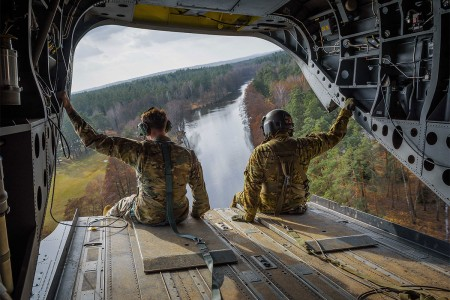 Soldiers with 12th Combat Aviation Brigade, observe the 7th Army Training Command's Grafenwoehr Training Area from the tailgate of a CH-47F Chinook during maneuvers training exercise, Germany, March 15, 2017.