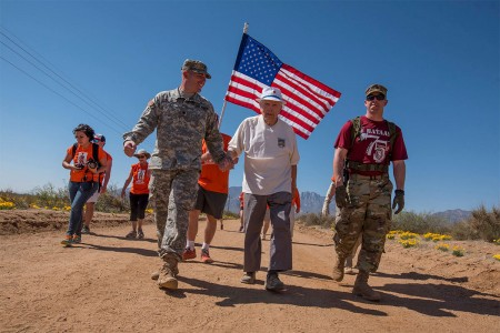 Retired Col. Ben Skardon, 99, a survivor of the Bataan Death March, walks in the annual Bataan Memorial Death March at White Sands Missile Range, N.M., accompanied by two Army medics, March 19, 2017. This was the tenth time Skardon walked in the march, and he is the only survivor who walks in the memorial march.