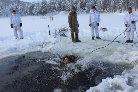 Paratroopers from the 91st Cavalry Regiment enter a frozen lake in the vicinity of Setermoen, Norway, 200 miles north of the Arctic Circle. After entering the frozen lake in full uniform with equipment, Paratroopers demonstrated their ability to stabilize their breathing and recover equipment, exit the water and change into dry clothes under their own power. Exercise Joint Viking is a multi-day joint and combined arms exercise bringing together elements of the U.S. Army, U.S. Marine Corps, Royal marines and Norwegian army, simulating high-intensity warfare in a challenging winter environment.