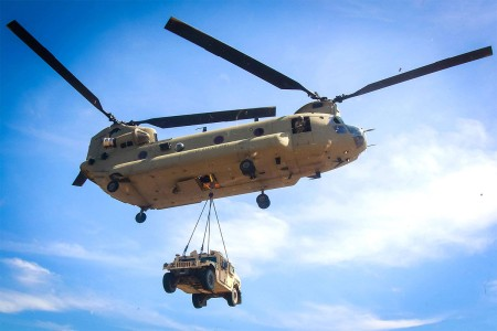 A CH-47F Chinook helicopter maneuvers with a sling loaded M1114 Up-Armored Humvee from 3rd Brigade Combat Team during a sling load training event at Saunders pick-up zone on Fort Bragg, N.C., April 4.