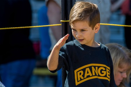 A child salutes during the 2017 Best Ranger Competition at Fort Benning, Ga., April 9, 2017.