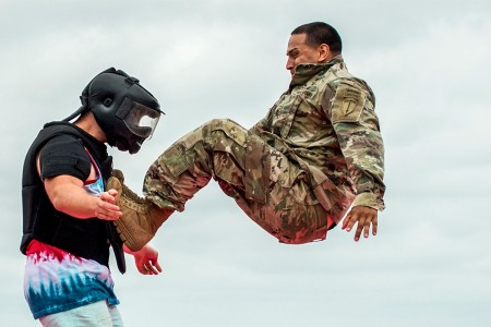 "A Soldier demonstrates hand-to-hand combat on a ""volunteer"" from the crowd during the 6th Ranger Training Battalion's open house event, April 29, at Eglin Air Force Base, Fla. The event was a chance for the public to learn how Rangers train and opera..."