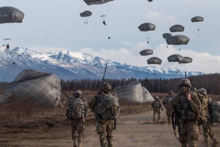 501st Parachute Infantry Regiment leaders observe as their follow-on paratroopers exit a U.S. Air Force C-17 Globemaster to join in the fight during  Joint Forcible Entry Operation exercise at Joint Base Elmendorf-Richardson, Alaska, May 3, 2017. Hundreds of paratroopers jumped from U.S. and Royal Canadian Air Force aircraft in conjunction with the biennial U.S. Air Force Alaska Command exercise Northern Edge in preparation for upcoming training at the Joint Readiness Training Center in Fort Polk, La.