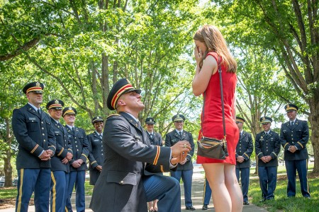 Newly commissioned second lieutenant proposes to his girlfriend immediately after his Clemson University Reserve Officers' Training Corps commissioning ceremony, May 10, 2017. The two met while they were students at Clemson.