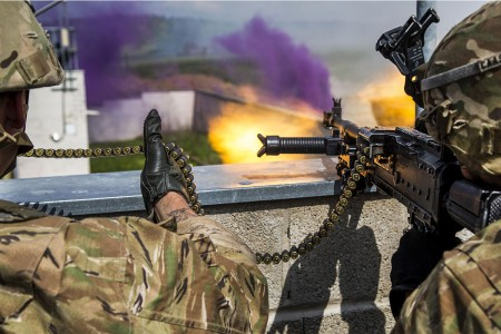 Soldiers of 175th Infantry Regiment National Guard return fire while conducting a town defense scenario during Saber Junction 17 at the Hohenfels Training Area, Germany, May 15, 2017. Saber Junction 17 includes nearly 4,500 participants from 13 NATO and European partner nations.