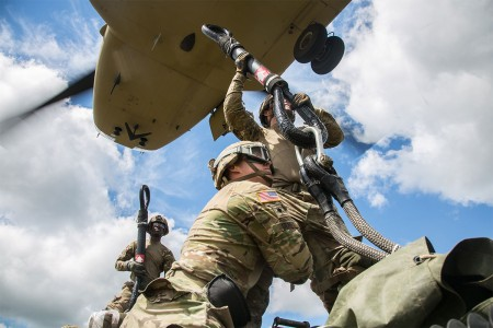 Soldiers assigned to 2nd Cavalry Regiment along with 10th Mountain Combat Aviation Brigade, conduct sling load and air assault training with M777A2 Howitzers, during Saber Strike 2017, at Bemowo Piskie Training Area near Orzysz, Poland, June 7, 2017.