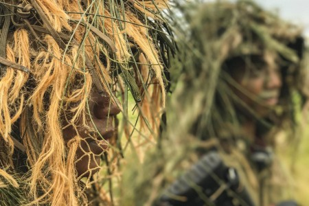 Soldiers of the 100th Battalion donned Ghillie suits, June 18, 2017, in preparation for their mock ambush on opposing forces during their annual training at Kahuku Training Area, Hawaii.