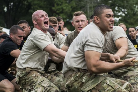 Soldiers from the 3rd U.S. Infantry Regiment (The Old Guard) and Marines from Joint Base Myer-Henderson Hall compete against each other in a tug-of-war challenge during the 4th annual Urban Warrior Challenge, June 22, 2017. The competition brings the Army and Marines together in games and challenges that help build team cohesion, camaraderie and offers something to do for the whole family.