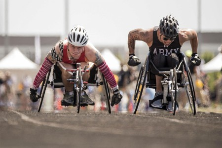 Marine Corps Cpl. Dakota Q. Boyer, left, and Army veteran Jhoonar Barrera compete in a wheelchair racing event during the 2017 Department of Defense Warrior Games in Chicago, July 2, 2017. The Warrior Games are an annual event allowing wounded, ill and injured service members and veterans to compete in Paralympic-style sports.