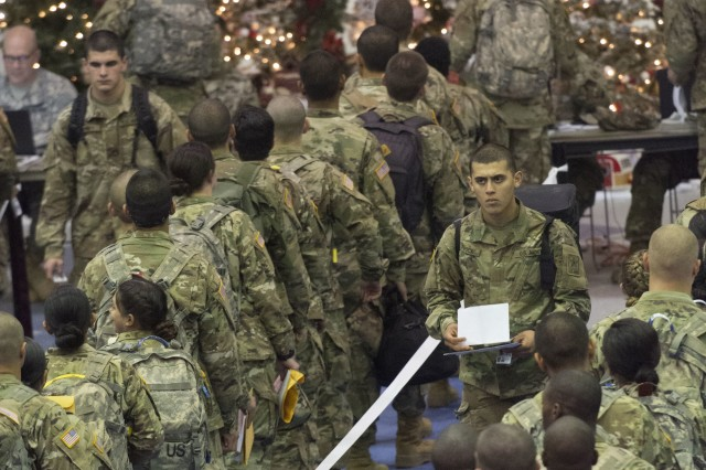 Trainees stand in line for processing at the Solomon Center on Fort Jackson, S.C., Dec. 18, 2017, as they prepare to depart on for Holiday Block Leave.