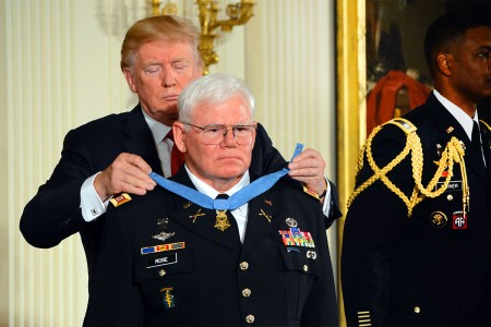 President Donald Trump places the Medal of Honor around the neck of Capt. Mike Rose, during an Oct. 23, 2017 ceremony at the White House, in Washington, D.C.