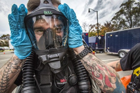 A survey team member of 21st Weapons of Mass Destruction-Civil Support Team, New Jersey National Guard, adjusts his breathing apparatus during an Army North mandated training proficiency evaluation at the Veterans Affairs Medical Center-Lyons, N.J., Oct. 25, 2017. The 21st WMD-CST's mission is to support civil authorities by identifying chemical, biological, radiological and nuclear substances in either man-made or natural disasters.