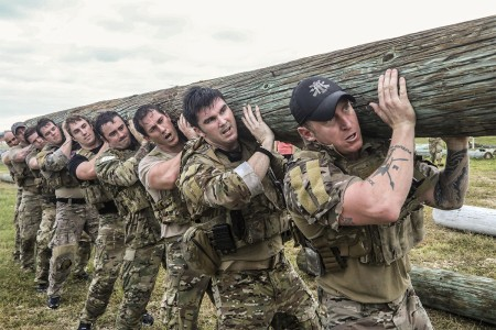 Soldiers assigned to the 1st Special Forces Group (Airborne), lifts a log during a battalion endurance event at Torii Station, Okinawa, Japan, Nov. 30, 2017. The event test Soldiers ability to assemble and disassemble the M249 light machine gun, radi...