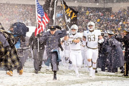 Black Knight football players charge onto the field for the 118th Army-Navy Game in Philadelphia, Dec. 10, 2017. Army beat Navy for the second straight year, 14-13.