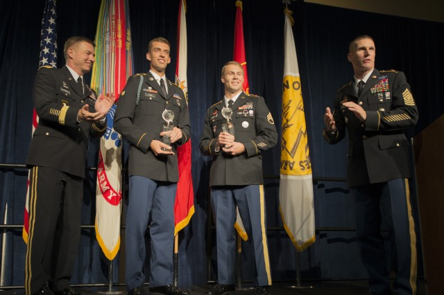 Spc. Hazen Ham, second from left, and Staff Sgt. Ryan McCarthy are congratulated by Sgt. Maj. of the Army Daniel A. Dailey and Gen. James C. McConville, the Army's vice chief of staff, during an award ceremony for Soldier and NCO of the Year at the Association of the U.S. Army's annual meeting and exposition in Washington, D.C., Oct. 9, 2017. Both Soldiers won the Best Warrior Competition, which was held Oct. 1-6 at Fort A.P. Hill, Virginia.