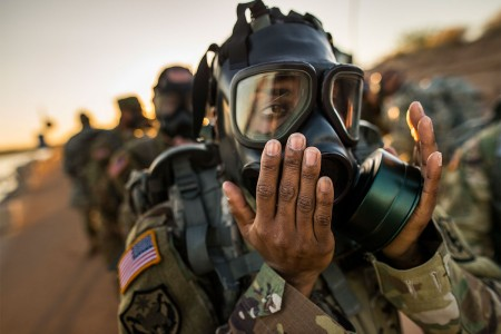 U.S. Army Reserve command sergeant major of the 400th Military Police Battalion dons and clears her gas mask during a team-building ruck march held by the 200th Military Police Command during a 'CSM Huddle' in Scottsdale, Ariz., Sept. 16, 2017.