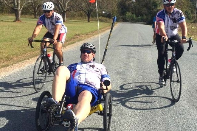 Capt. Jon Laton finishes the last few miles of the 36 mile course on his recumbent bike.
