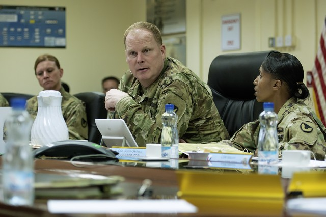 Maj. Gen. Duane Gamble, commanding general, U.S. Army Sustainment discusses materiel readiness with 401st Army Field Support Brigade leadership at Camp Arifjan, Kuwait, Nov. 14. (U.S. Army Photo by Justin Graff, 401st AFSB Public Affairs)