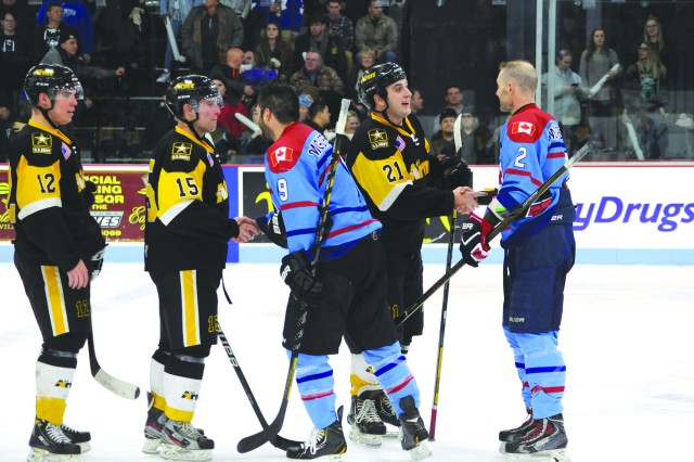 Capt. Andrew Starczewski, No. 21, scored two goals in the win for the All-Army Ice Hockey Team and was named one of the game's star players. Starczewski, assigned to 1st Battalion, 30th Field Artillery Regiment, Fort Sill, La., previously played Division I hockey before commissioning from the U.S. Military Academy at West Point in 2013.