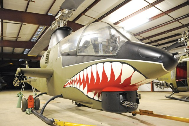 This AH-1 G-model Cobra sits in storage at the U.S. Army Aviation Museum and sports a unique paint job, featuring a shark's mouth, which many consider synonymous with the Cobra look.