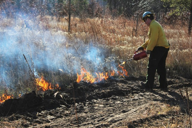 Post personnel oversee a prescribed burn Nov. 30, 2017, at Range 100 on South Post at Fort McCoy, Wis. Personnel with the Fort McCoy Directorate of Emergency Services Fire Department; Directorate of Public Works Environmental Division Natural Resources Branch; Directorate of Plans, Training, Mobilization and Security; and the Colorado State University Center of Environmental Management of Military Lands under contract with the post help coordinate each prescribed burn at the post. Prescribed burns, generally, are done in the spring and fall seasons because weather conditions are most favorable at those times. Prescribed burns also improve wildlife habitat, control invasive plant species, restore and maintain native plant communities, and reduce wildfire potential. (U.S. Army Photo by Scott T. Sturkol, Public Affairs Office, Fort McCoy, Wis.)