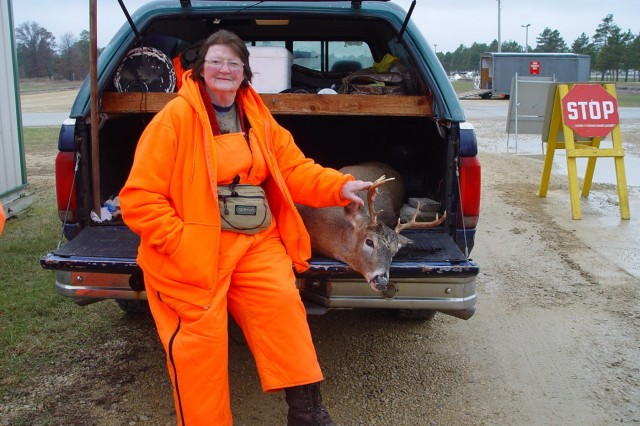 Local hunter Leona Tesar, pictured here on Nov. 18, 2017, harvested this buck at Fort McCoy, Wis., early in the season. Hundreds of deer were harvested during the 2017 gun-deer season at the installation. (Photo by Kevin Luepke, Colorado State University Center for Environmental Management of Military Lands under contract with Fort McCoy)