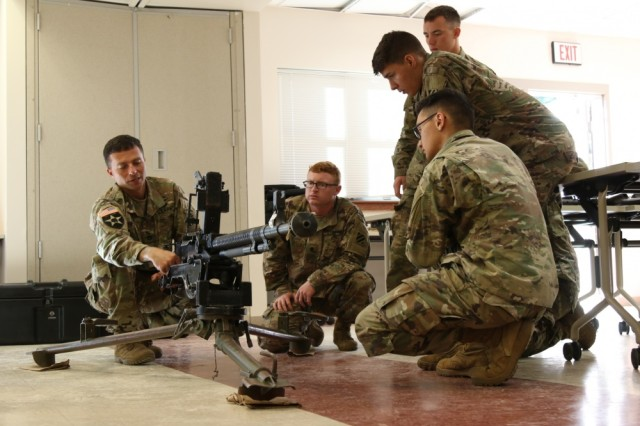 Soldiers from Task Force 1st Battalion, 28th Infantry Regiment, conduct a foreign weapons familiarization on a Russian DShk heavy machine gun Oct. 25 at Fort Benning, Georgia. TF 1-28 Soldiers are attached to 1st Security Force Assistance Brigade as a security element to advisers enabling teams to focus on supporting their foreign security force partners. Soldiers interested in joining the 1st Security Force Assistance Brigade should contact their branch manager for more information