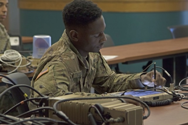 Pfc. Willie McCree, an infantryman from the 1st Battalion, 28th Infantry Regiment Task Force, learns how to operate a One System Remote Video Terminal in Fort Benning, Georgia, Oct. 26. Task Force 1-28 received the training to support the 1st Security Force Assistance Brigade as a security force element.