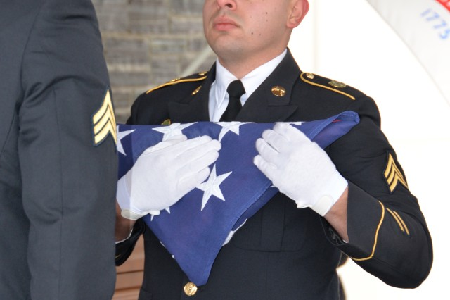 New York Army National Guard Sgt. Ramon Rodriguez, folds a U.S. flag for Army Veteran 2nd Lt. Francis Wermert during his burial at Gerald B.H. Solomon Saratoga National Cemetery, in Schuylerville, N.Y. on December 15, 2017. Wermert served in the U.S. Army from 1943-46.