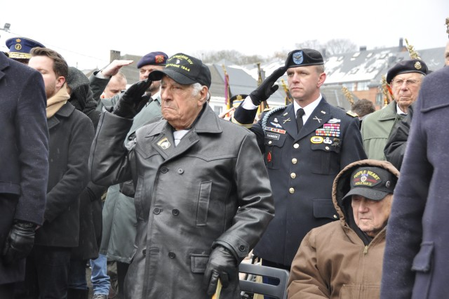 Vince Speranza, a World War II infantryman who served in the Battle of the Bulge, salutes during a wreath-laying ceremony at Gen. George Patton's memorial during the battle's 73rd An-niversary parade Dec. 16, 2017, in Bastogne, Belgium.