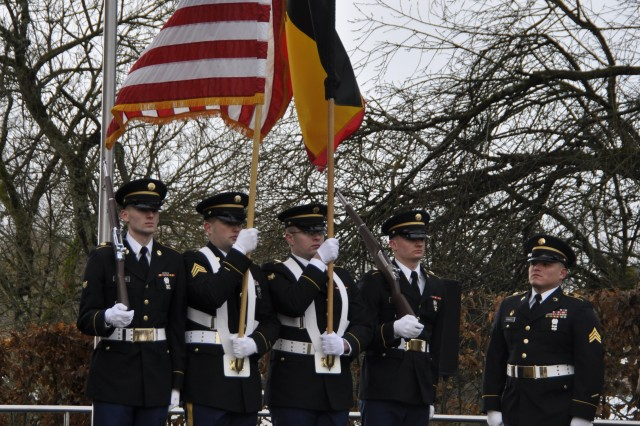 From left to right: Army Spc. Douglas Lanning, Sgt. Ryan Boxberger, Spc. Carl Brown, Spc. Cole Martin and Sgt. Erik Ramirez serve as the color guard for U.S. Army Garrison Benelux during the Battle of the Bulge's 73rd Anniversary parade Dec. 16, 2017, in Bastogne, Belgium.