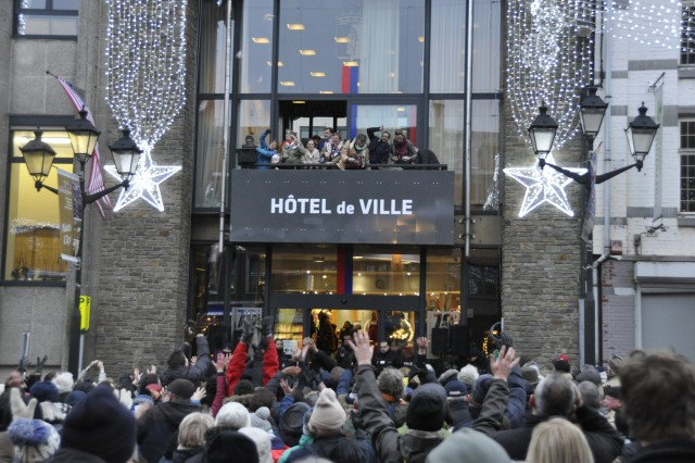 Special guests throw nuts off the city hall's balcony during the Battle of the Bulge's 73rd Anniversary commemoration Dec. 16, 2017, in Bastogne, Belgium.