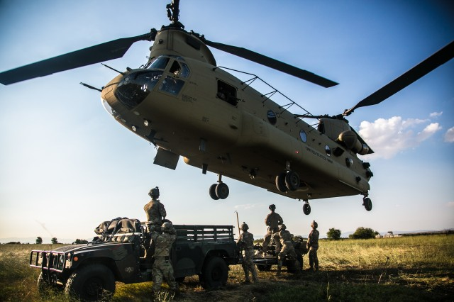 U.S. Army Paratroopers from Alpha Battery, 4th Battalion, 319th Airborne Field Artillery Regiment, 173rd Airborne Brigade, conduct a slingload operation in Bezmer Airfield, Bulgaria on July 19, 2017 during exercise Saber Guardian. Saber Guardian 17 is an annual, multi-national exercise that aims to assure our Allies and partners of the enduring U.S. commitment to the collective defense and prosperity of the Black Sea region.