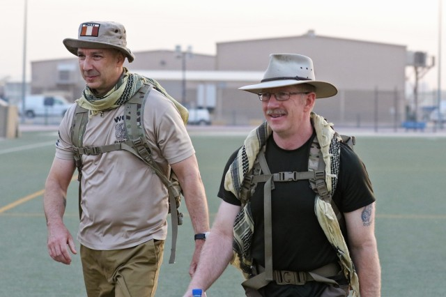 Chief Warrant Officer 3 Billie Hancock (right), human resources officer, 35th Infantry Division, uses his off-duty time to explore Camp Arifjan, Kuwait.
