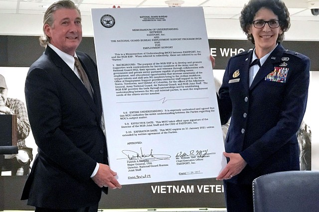 Air Force Brig. Gen. Jessica Meyerann, the vice director of personnel with the joint staff of the National Guard Bureau, and Bill McClennan, CEO of FASTPORT, a national employment services company, hold up a copy of the memorandum of understanding signed during a ceremony at the Pentagon recently. FASTPORT is one of a number of organizations and entities the NGB has partnered with to provide Guard members assistance with finding civilian employment opportunities.