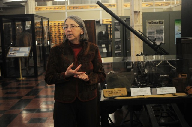 Kris Leinicke, director, Rock Island Arsenal Museum, discusses her experiences working at the museum Dec. 11. (Photo by Linda Lambiotte, ASC Public Affairs)