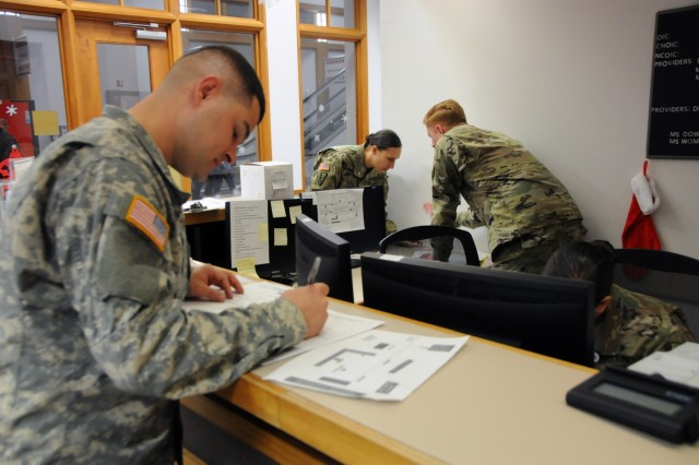 2nd Lt. Joel Lucas, a North Carolina Army National Guard Soldier assigned to Bravo Battery, 1-113th Field Artillery Bn. based out of Monroe, signs in to get his periodic health assessment completed at Operation Reserve Care, located inside Womack Army Medical Center at Fort Bragg, N.C. Operation Reserve Care, run by Army Reserve Medical Command's 7458th Medical Backfill Bn., provides medical services to assist Army Reserve, National Guard and Active Component Soldiers in improving their individual medical readiness.  Available once a month, these services include Periodic Health Assessments, dental, audiology, optometry, immunizations, profiles and basic medical services if needed.