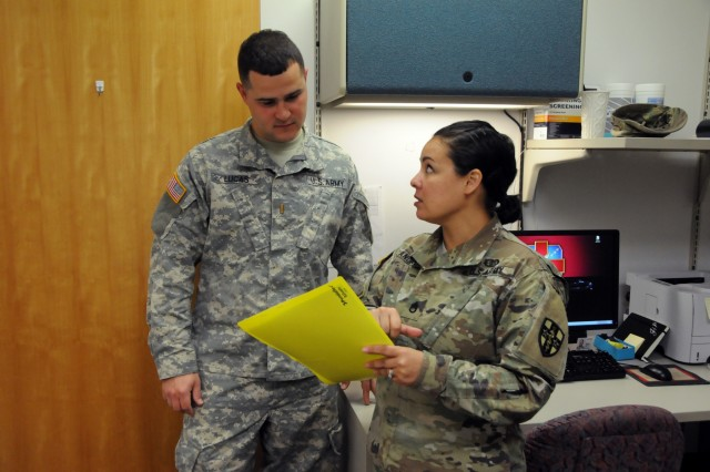 2nd Lt. Joel Lucas, a North Carolina Army National Guard Soldier assigned to Bravo Battery, 1-113th Field Artillery Bn. based out of Monroe, meets with the audiologist and non-commissioned officer for Operation Reserve Care, Staff Sgt. Johanna Landry, who goes over results from the hearing test during a periodic health assessment at Operation Reserve Care, located inside Womack Army Medical Center at Fort Bragg, N.C. Operation Reserve Care, run by Army Reserve Medical Command's 7458th Medical Backfill Bn., provides medical services to assist Army Reserve, National Guard and Active Component Soldiers in improving their individual medical readiness.  Available once a month, these services include Periodic Health Assessments, dental, audiology, optometry, immunizations, profiles and basic medical services if needed.