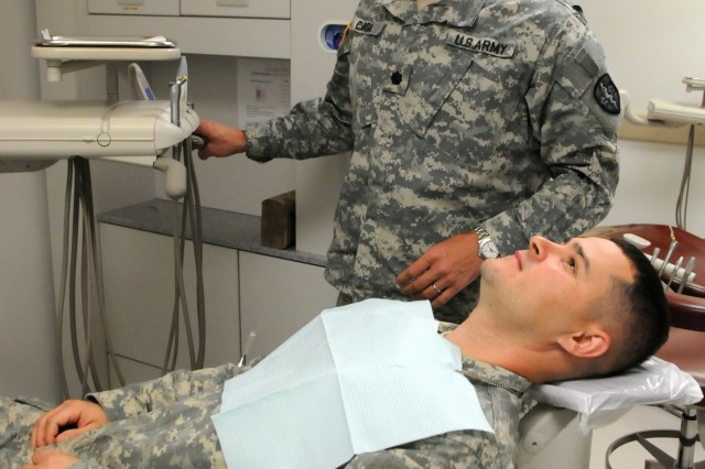 2nd Lt. Joel Lucas, a North Carolina Army National Guard Soldier assigned to Bravo Battery, 1-113th Field Artillery Bn. based out of Monroe, meets with Lt. Col. Jose Cangas, a general dentist assigned to the 7458th Medical Backfill Bn., to complete a dental exam for a periodic health assessment at Operation Reserve Care, located inside Womack Army Medical Center at Fort Bragg, N.C. Operation Reserve Care, run by Army Reserve Medical Command's 7458th Medical Backfill Bn., provides medical services to assist Army Reserve, National Guard and Active Component Soldiers in improving their individual medical readiness.  Available once a month, these services include Periodic Health Assessments, dental, audiology, optometry, immunizations, profiles and basic medical services if needed.