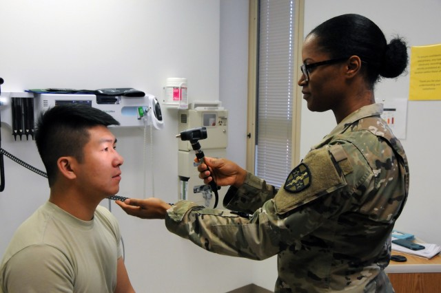 Spc. Shuya Chang, an Army Reserve Soldier assigned to 7226th Medical Support Unit, based out of Fort Jackson, South Carolina, meets with physician assistant, Capt. Erika Walker, for a periodic health assessment at Operation Reserve Care, located inside Womack Army Medical Center at Fort Bragg, N.C. Operation Reserve Care, run by Army Reserve Medical Command's 7458th Medical Backfill Bn., provides medical services to assist Army Reserve, National Guard and Active Component Soldiers in improving their individual medical readiness.  Available once a month, these services include Periodic Health Assessments, dental, audiology, optometry, immunizations, profiles and basic medical services if needed.