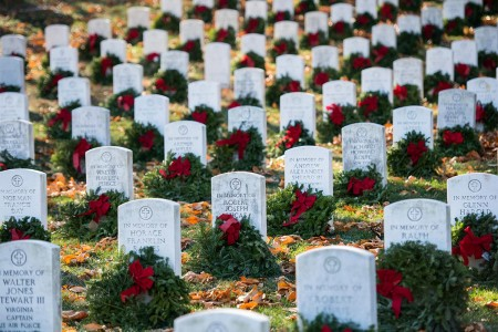 Wreaths on memorial markers in section E during Wreaths Across America event at Arlington National Cemetery, Arlington, Va., Dec. 16, 2017. On this day, volunteers place wreaths at every gravesite at Arlington National Cemetery.