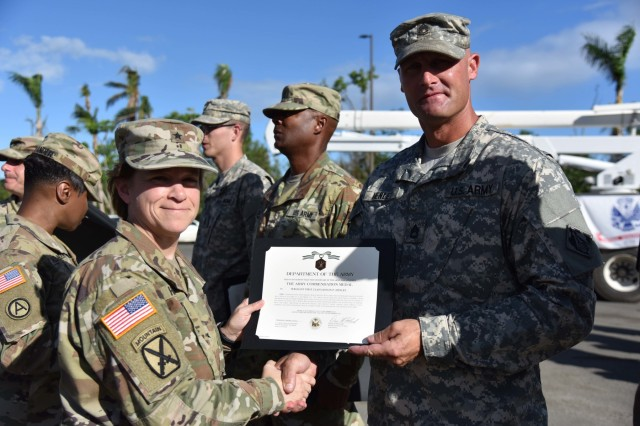 Sgt. 1st Class Jason Henley a Platoon Sgt. assigned to Delta Company, 249th Engineer Battalion (Prime Power) received an award for his work during hurricane recovery operations in Puerto Rico. The award was presented by USACE South Atlantic Division Commander Brig. Gen. Diana Holland.