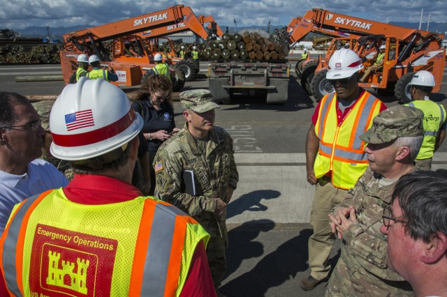 Lt. Gen. Todd Semonite, right, U.S. Army Corps of Engineers commanding general and Chief of Engineers, visits USACE personnel assigned to the Ponce Port, Puerto Rico, receiving shipments of material to repair the power grid. On site are hundreds of utility poles and miles of transmission line.
