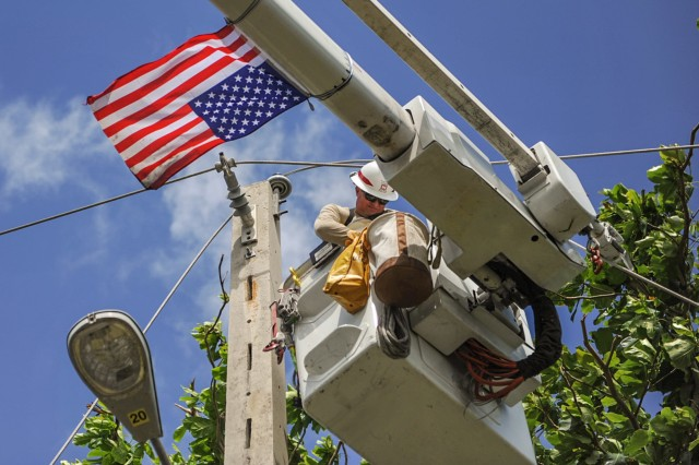 U.S. Army Reserve Sgt. Eric Elder, a power distribution specialist assigned to Delta Company, 249th Engineering Battalion, U.S. Army Corps of Engineers, fixes downed power lines caused by Hurricane Maria to help restore power in the Rio Grande, Puerto Rico area, October 25, 2017.