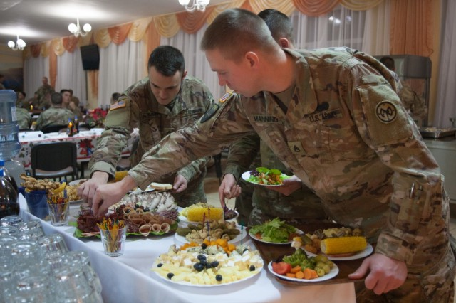 Yavoriv, Ukraine - 27th Infantry Brigade Combat Team Soldiers assigned to the Joint Multinational Training Group - Ukraine host a Christmas dinner at the Yavoriv Combat Training Center near Yavoriv, Ukraine. Currently more than 220 of the Brigade's Soldiers are deployed overseas working alongside the Ukrainian Army.
